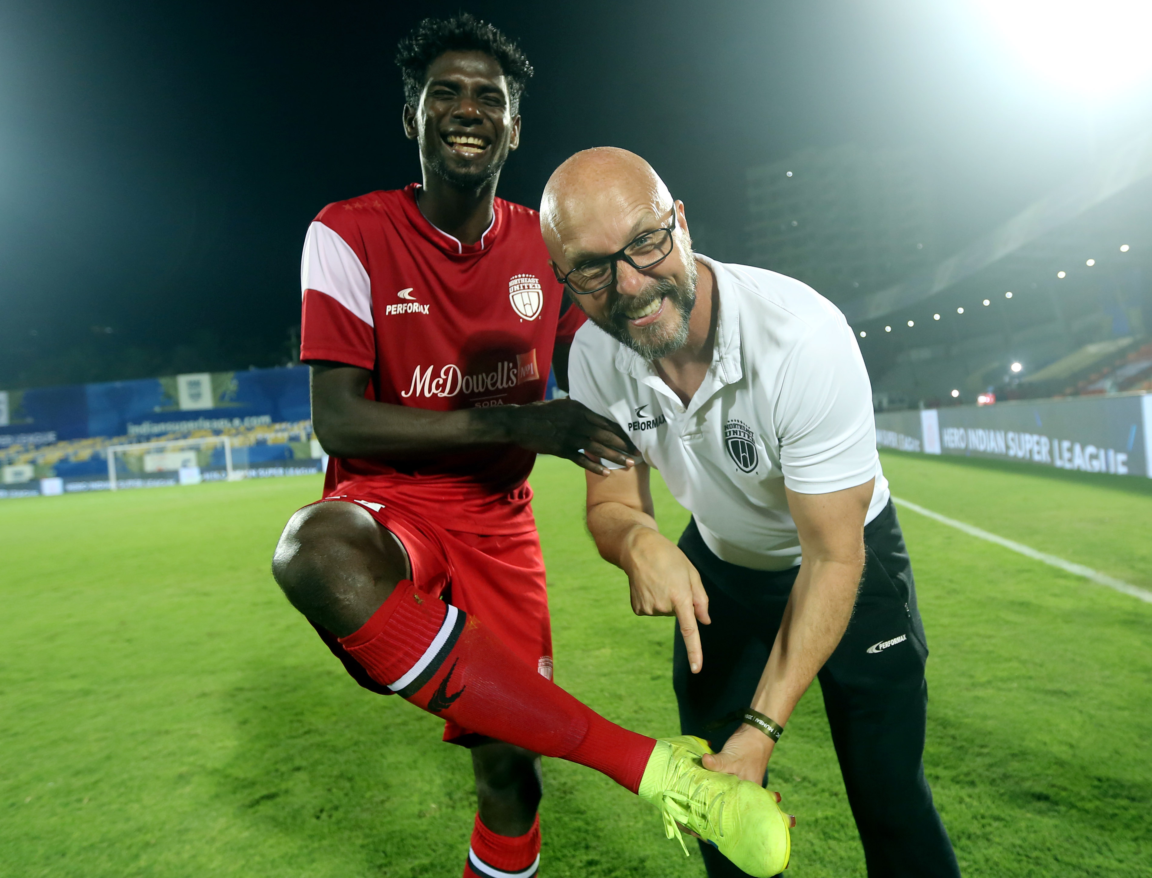 Rowllin Borges of Northeast United FC and Eelco Schattorie