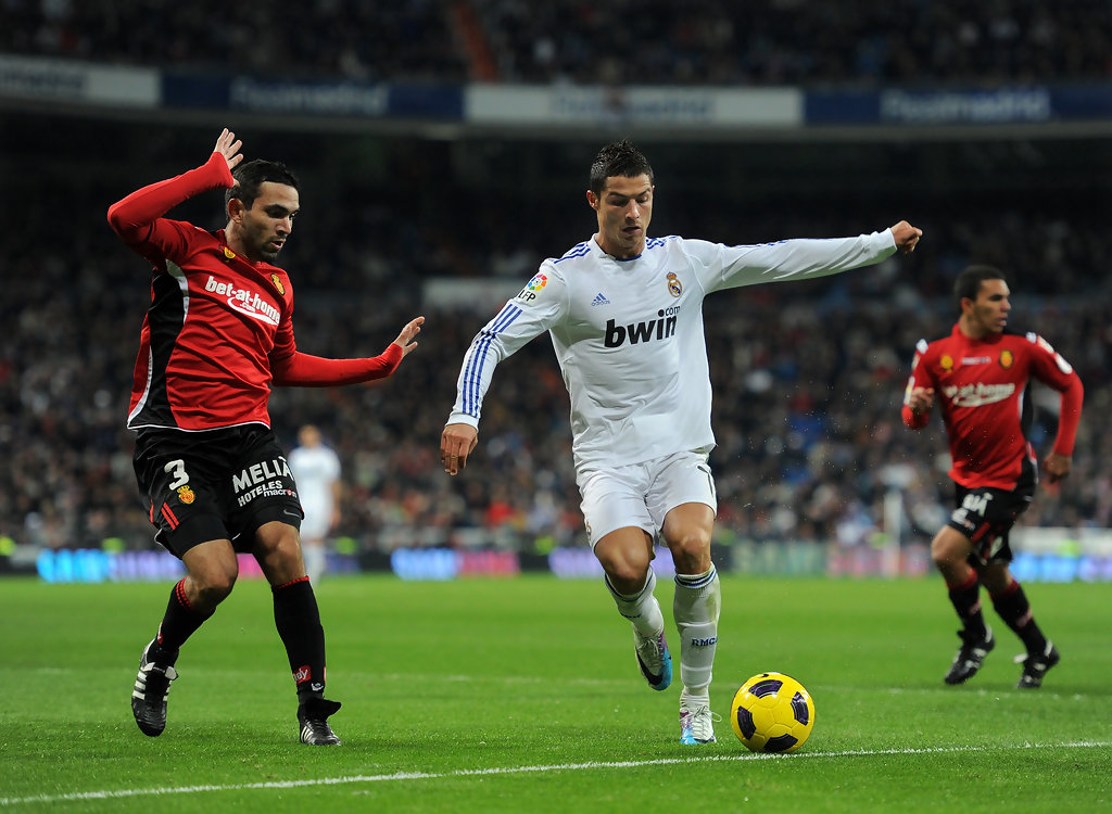 Cristiano Ronaldo (R) of Real Madrid duels for the ball with Joao Victor of Mallorca during the la liga match between Real Madrid and Mallorca at Estadio Santiago Bernabeu on January 23, 2011 in Madrid, Spain. (Jan. 22, 2011 - Source: Jasper Juinen/Getty Images Europe)