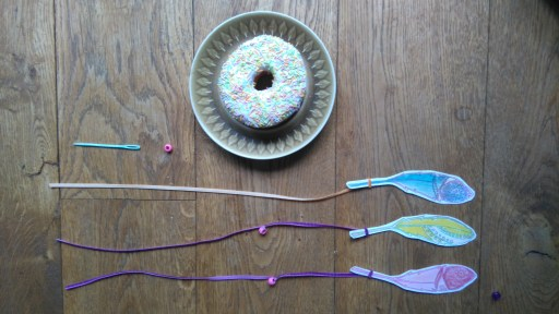 feathers attached to ribbon ready to attach to your doughnut