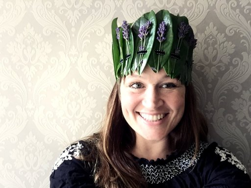 Ulla Lake wearing a woven laurel and lavender crown