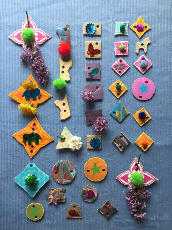 create a colourful selection of kids recycled cardboard art threadable shapes with flowers and unicorns