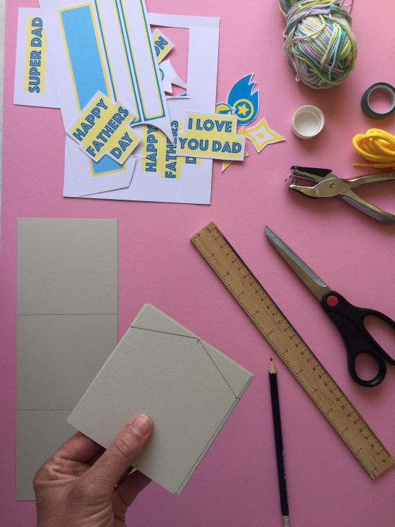 Cut pointy shapes to the bunting, to create your superhero themed kids homemade fathers day bunting