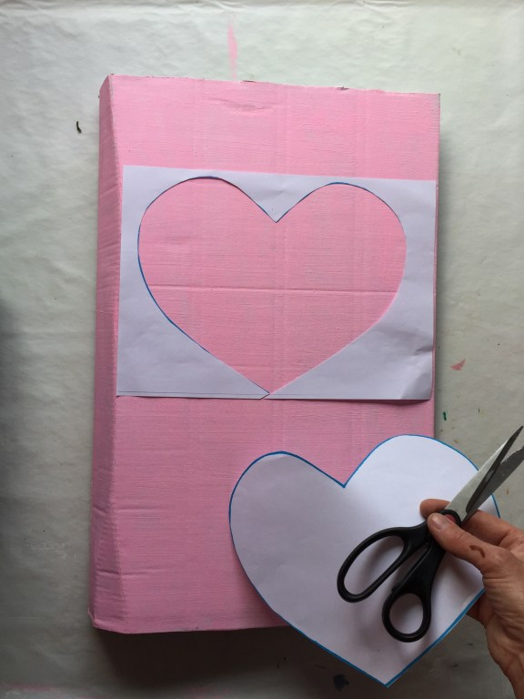 mark out the heart shape on the cardboard