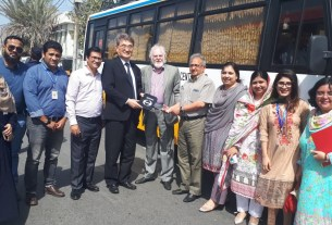 """Japanese Government hands over a """"Modern Transport Vehicle for Karachi Vocational Training Centre(KVTC), Consulate General of Japan in Karachi Mr. Toshikazu Isumora Presnting Donate Bus to Dr. Akhtar Aziz Khan, President of KVTC, and Senator Abdul Haseeb Khan, CEO of KVTC."""