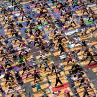 Is Yoga in Times Square a Symbol of Arrogance, Super Sexy Up-Dogs, or Both?