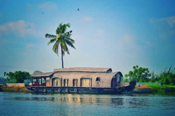 houseboat on river among exotic nature