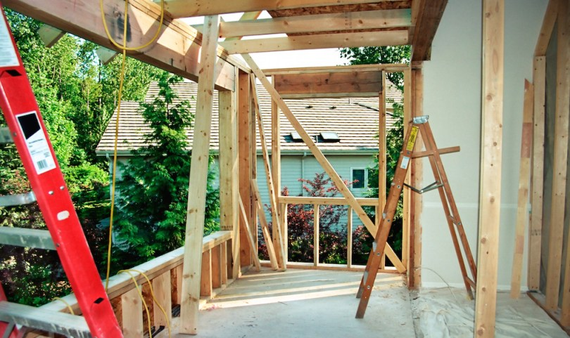House-under-construction-frame-ladders