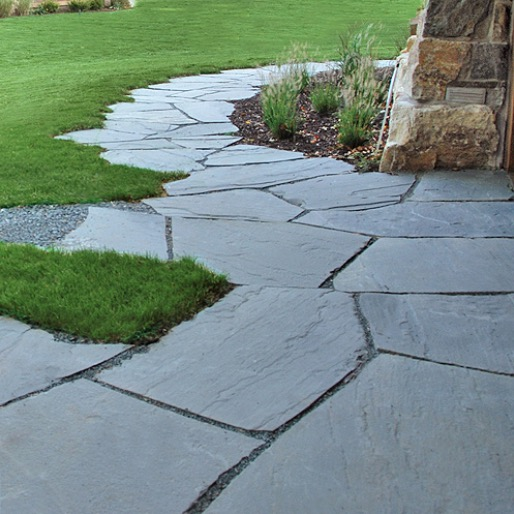 flagstone patio with grass joints the