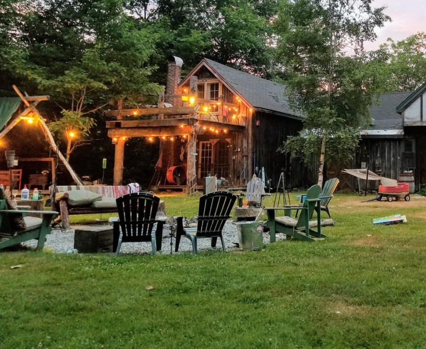 backyard fire pit area surrounded by chairs