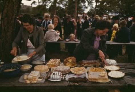 vintage photograph of potluck farm dinner