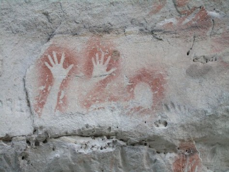 ancient rock painting of hands and fingers