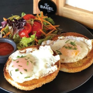 Fried eggs on bagel breakfast from The Bagel Co Rose Bay