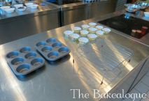 Muffin tray, cases, and cooling rack set up to be used at each work station