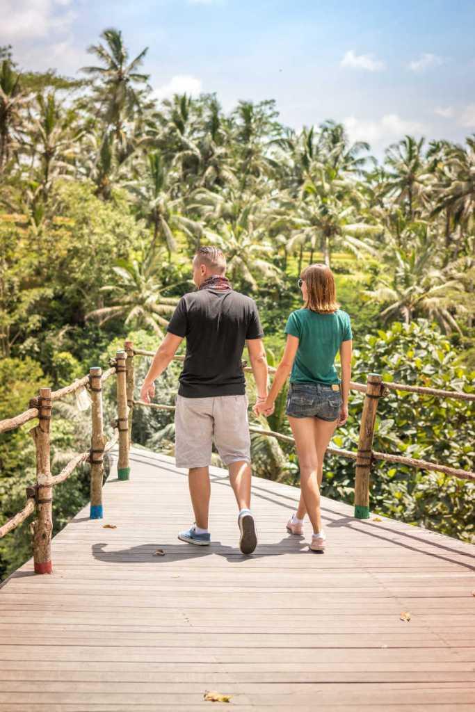 bali tourist walking near jungle