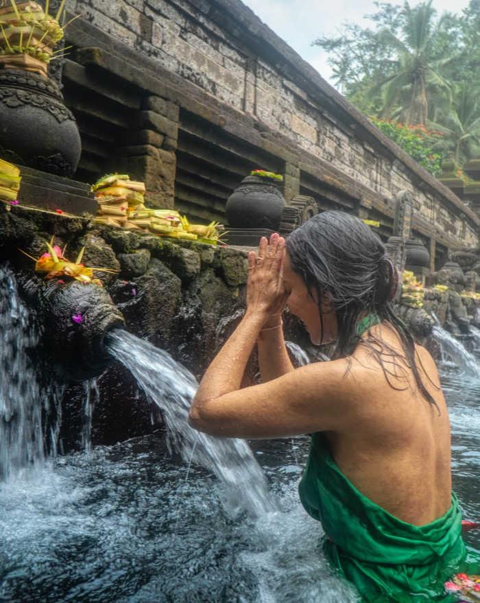 Australian Tourist prays in Bali fountain