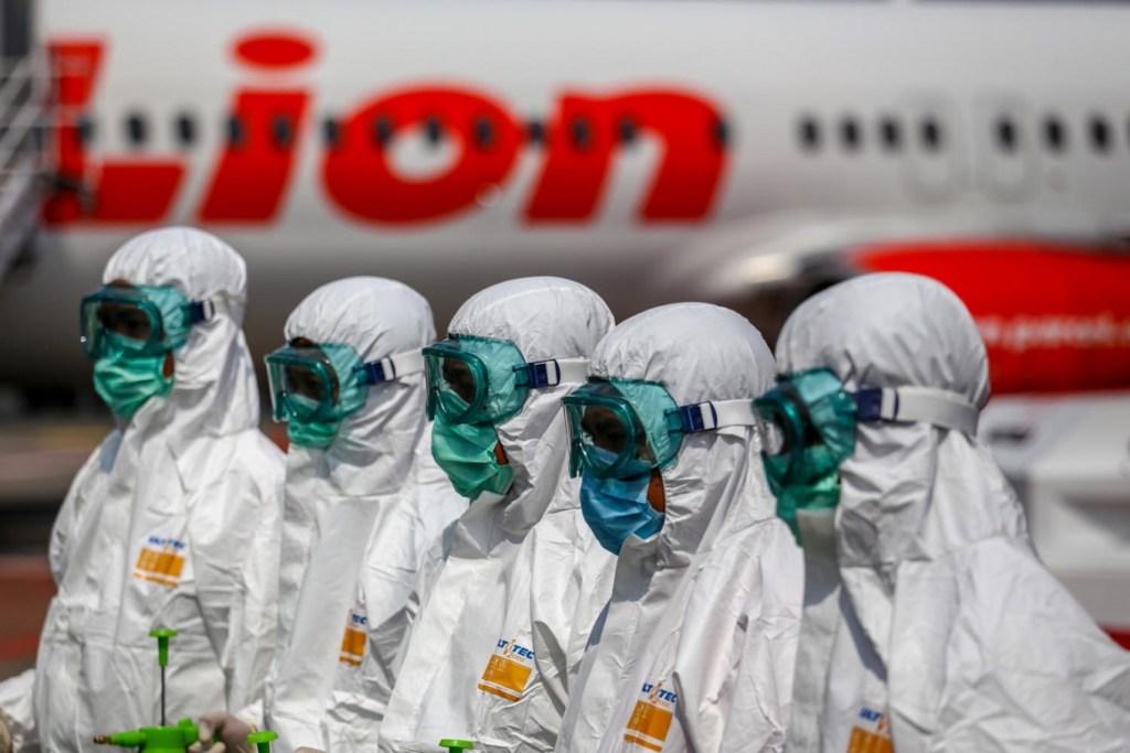 Lion Air workers in hazmat suits