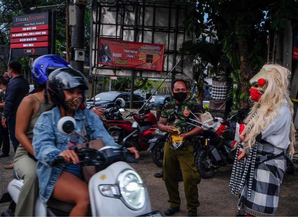 Bali locals with mask and culture