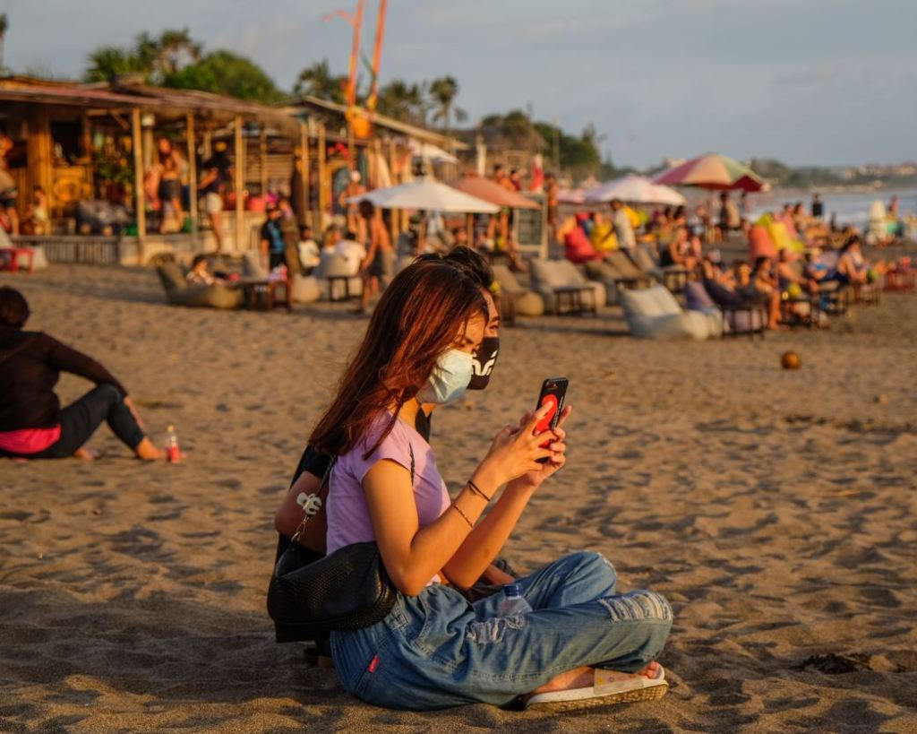 bali domestic tourists masks on beach