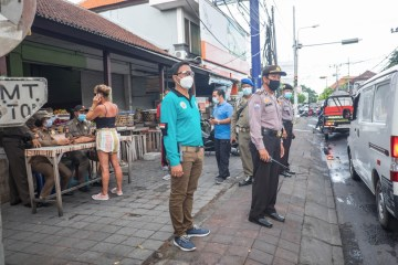 Trans Woman Arrested After Damaging Expat's Car In Kuta