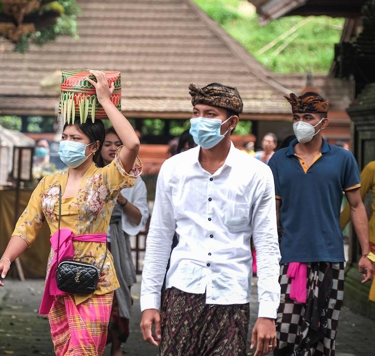 Bali locals in masks