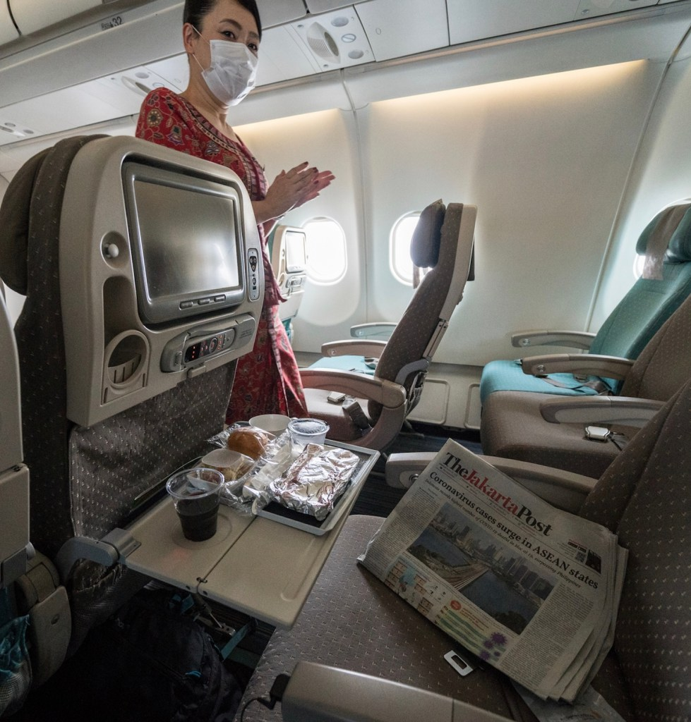 flight attendant in mask Bali