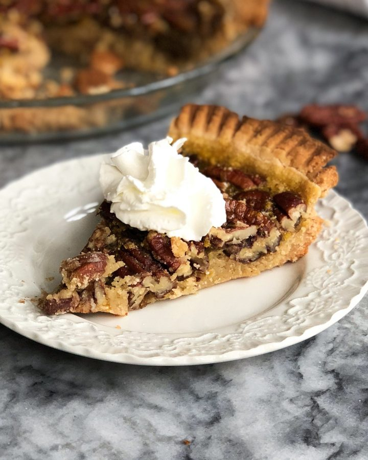 Paleo pecan pie that's gluten free, dairy free, and refined sugar free, and the perfect addition to any holiday table! You won't even be able to taste the difference from a traditional pie!