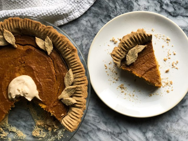 Paleo pumpkin pie made with real and simple ingredients. This is the perfect star dessert for any Thanksgiving table, especially with a dollop of coconut cream on top!