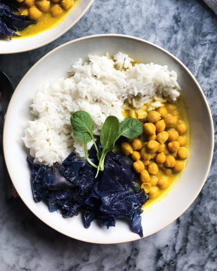 Easy Vegan Coconut Chickpea Curry with a side of steamed purple cabbage and jasmine rice for an easy week night dinner. This chickpea curry is perfect for a cold day and kid-friendly!