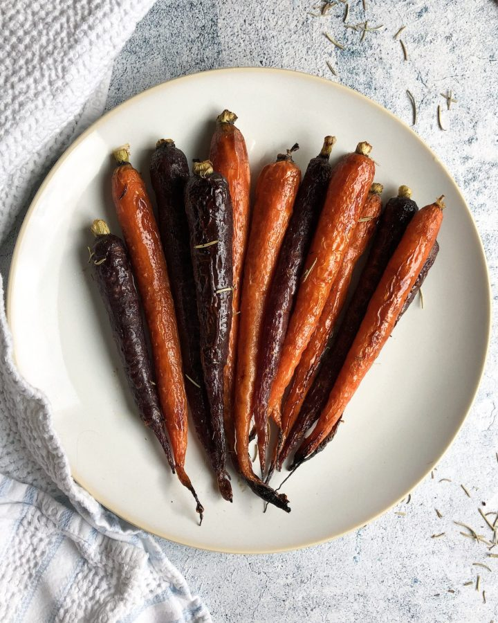 These paleo vegan glazed carrots are roasted in a maple syrup-balsamic dressing and are the perfect side dish to any fall or holiday meal!