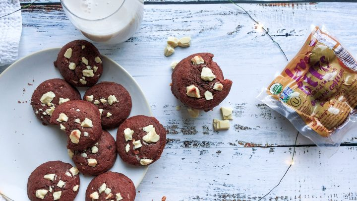 Healthy Red Velvet Cookies topped with organic white chocolate chunks for the most delicious and soft holiday cookie! Made without any funky dyes, they're perfect for a cookie exchange or Santa!