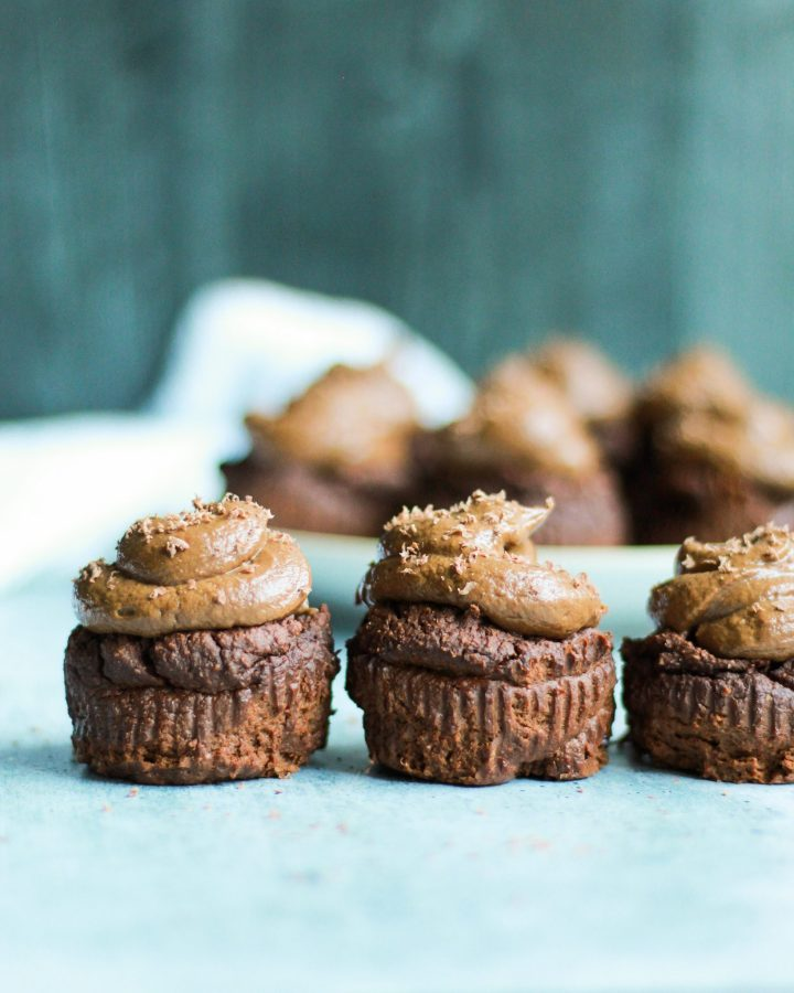 These paleo chocolate cupcakes with chocolate avocado frosting are incredibly easy and filled with nut butter! They're the perfect treat for all ages and completely gluten free!