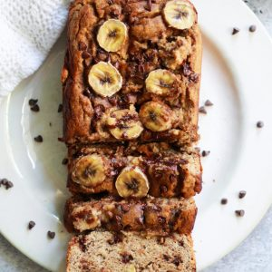 This Paleo Banana Bread with chocolate chips is so easy and delicious, yet tastes like a traditional banana bread! It also contains no added sugar and is completely gluten free!