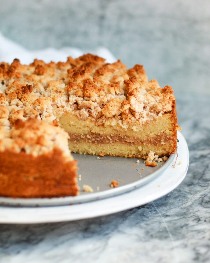 paleo cinnamon coffee cake with a slice out of it