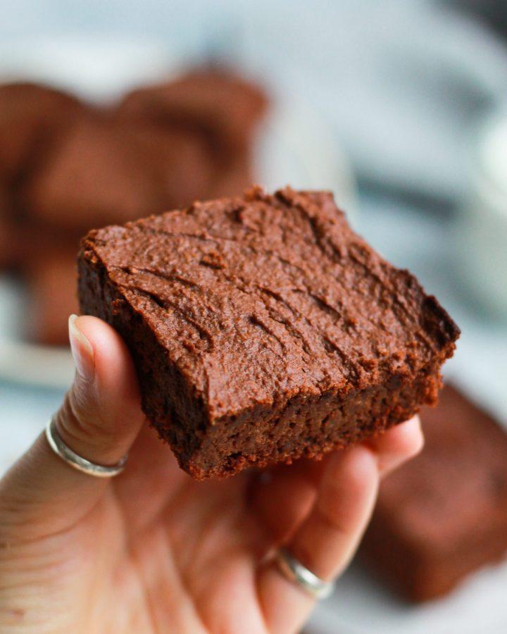 One healthy vegan Nutella brownies held by hand