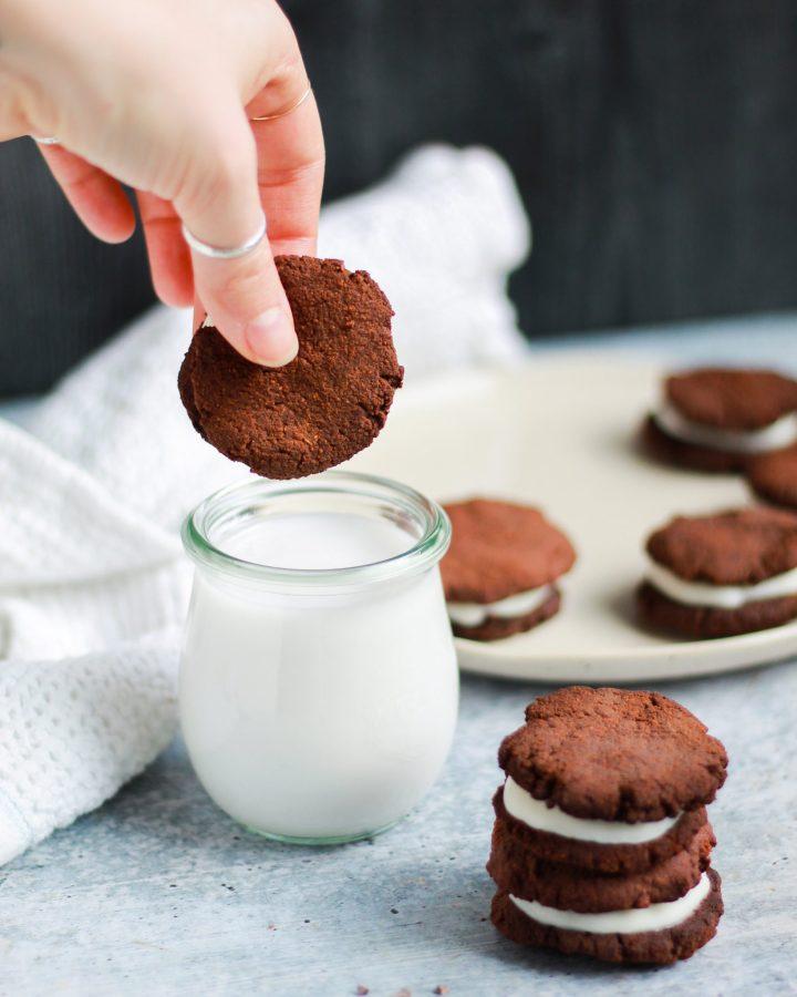 dunking a paleo vegan Oreo into coconut milk