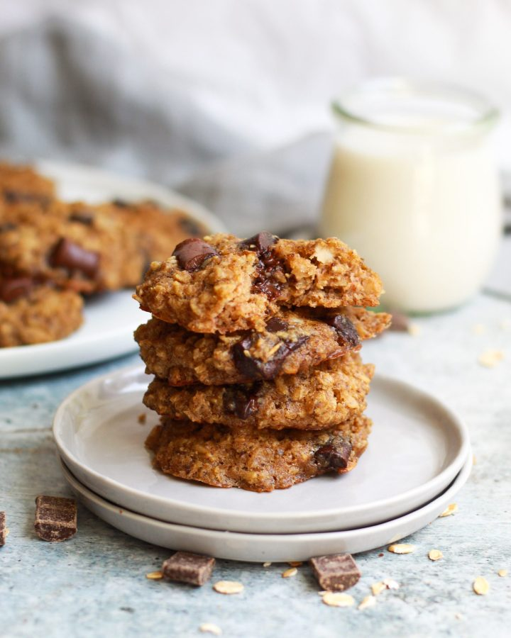 stack of four vegan oatmeal chocolate chip cookies