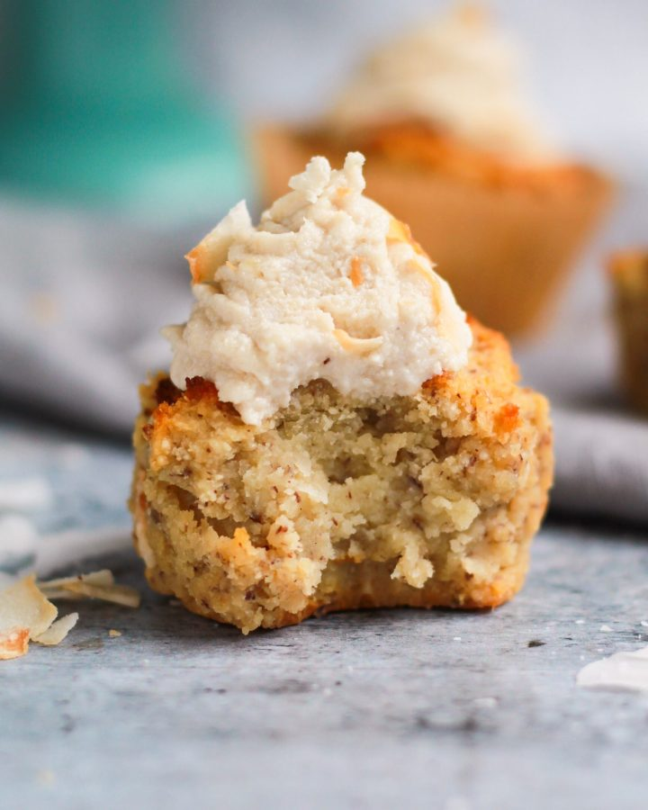 healthy coconut cupcake with bite taken out of it