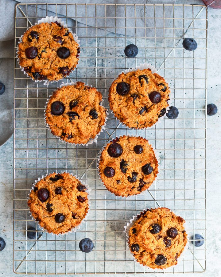 six vegan blueberry muffins on a cooling rack