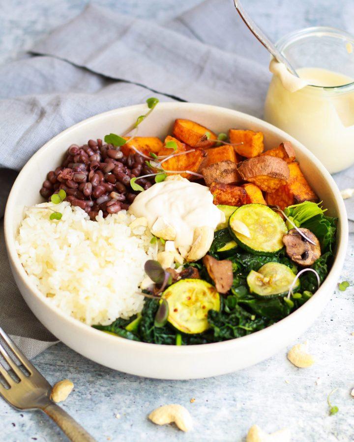 3/4 shot of macrobiotic bowl with vegan tahini sauce
