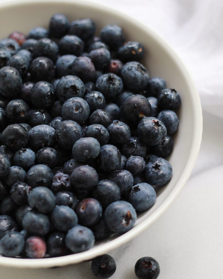 white bowl with fresh blueberries