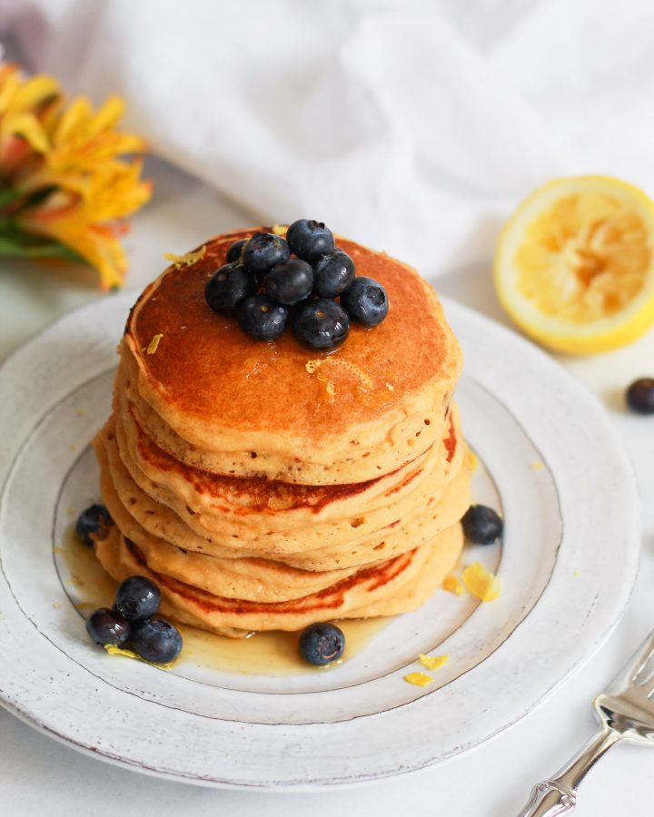 lemon ricotta pancakes drizzled in maple syrup