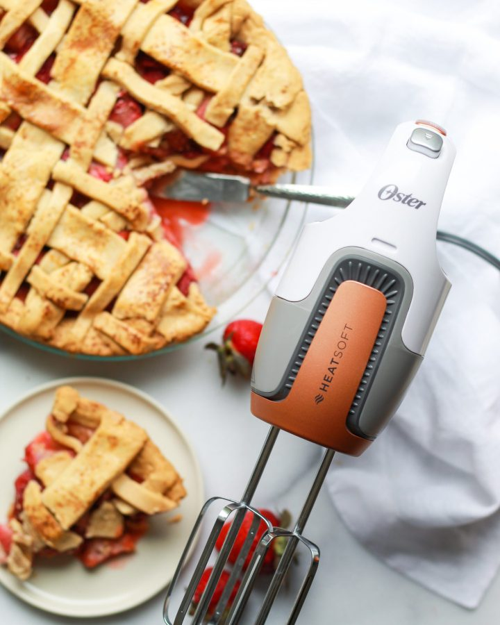 Oster hand mixer near strawberry rhubarb pie