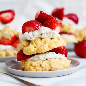 paleo strawberry shortcake stacked on a grey plate