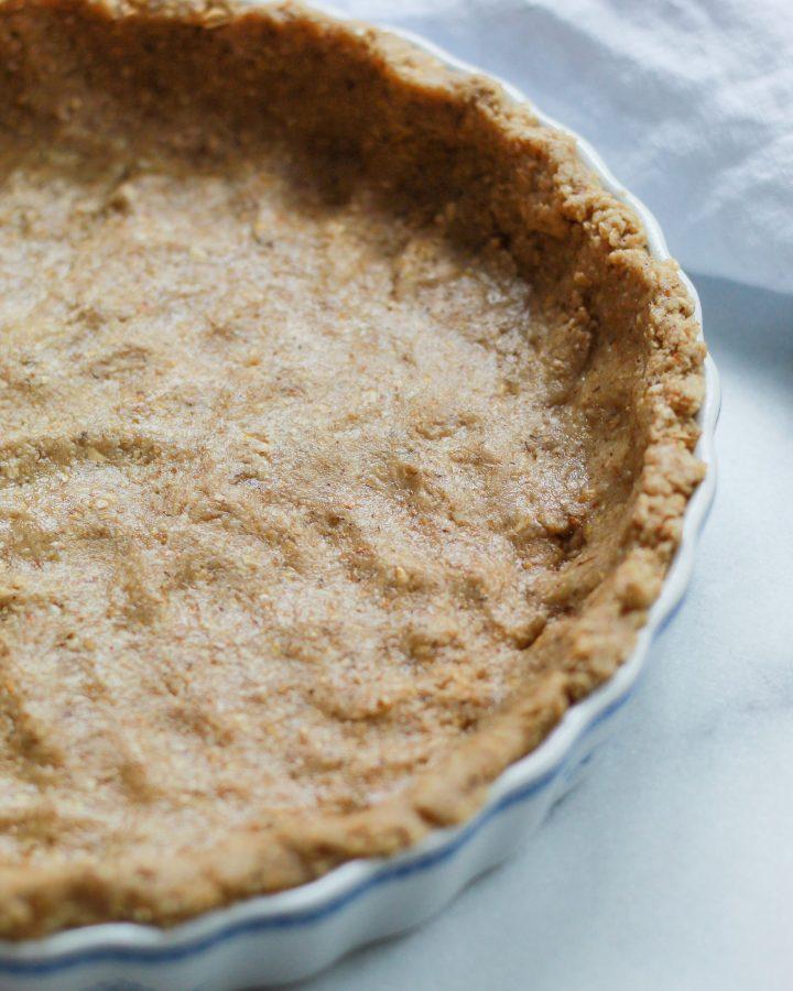 oat flour pie crust pressed into pie dish before baking