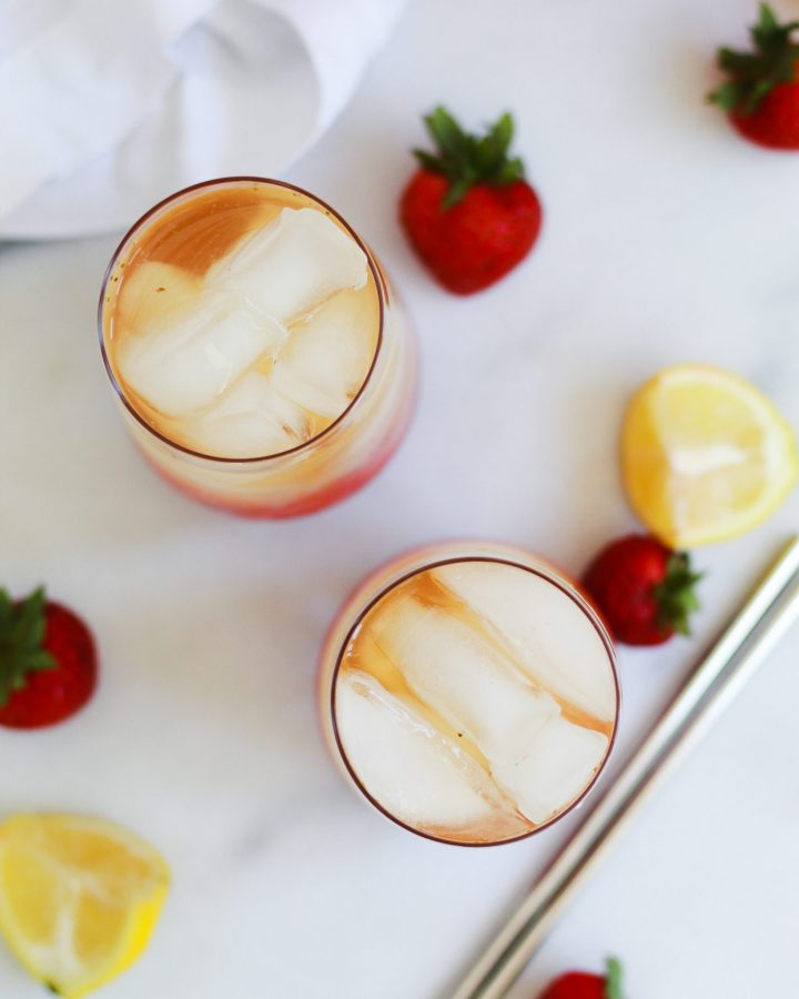 overhead of iced teas with strawberries and lemons
