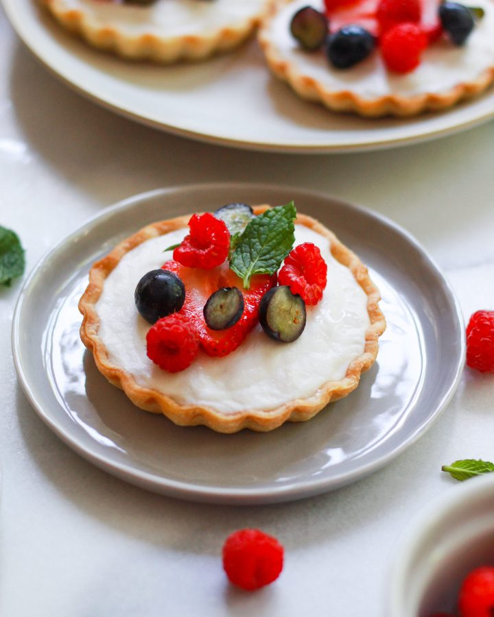 vegan fruit tart on a grey plate