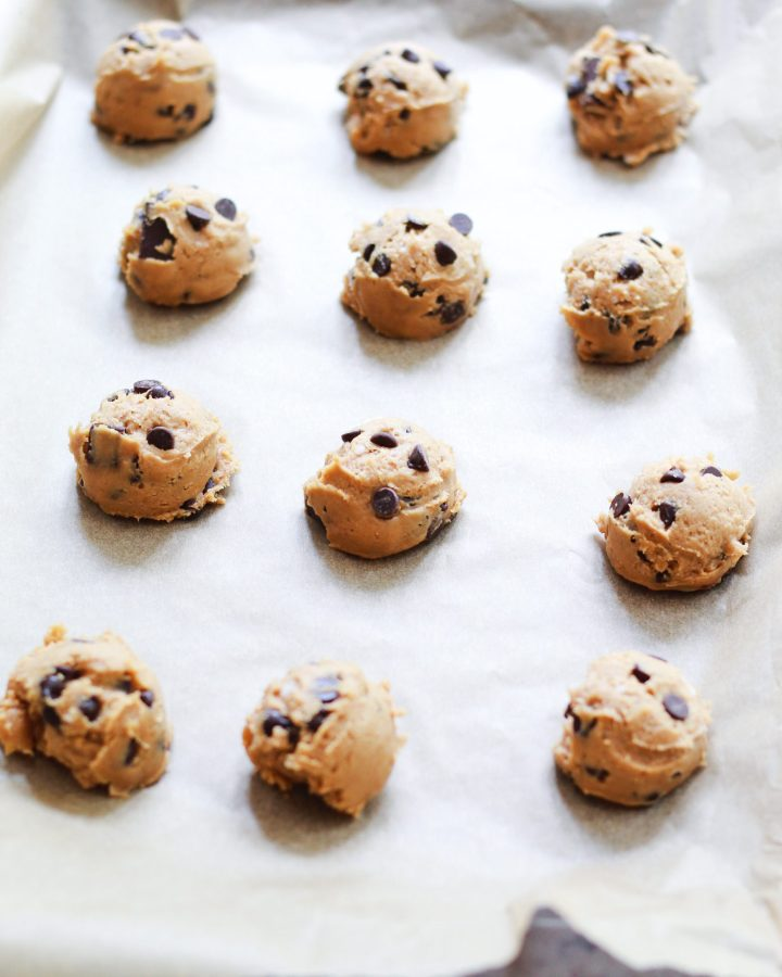 cookie dough balls on parchment paper