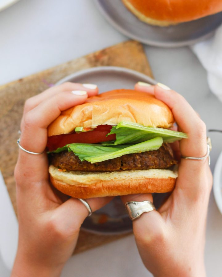hands holding burger
