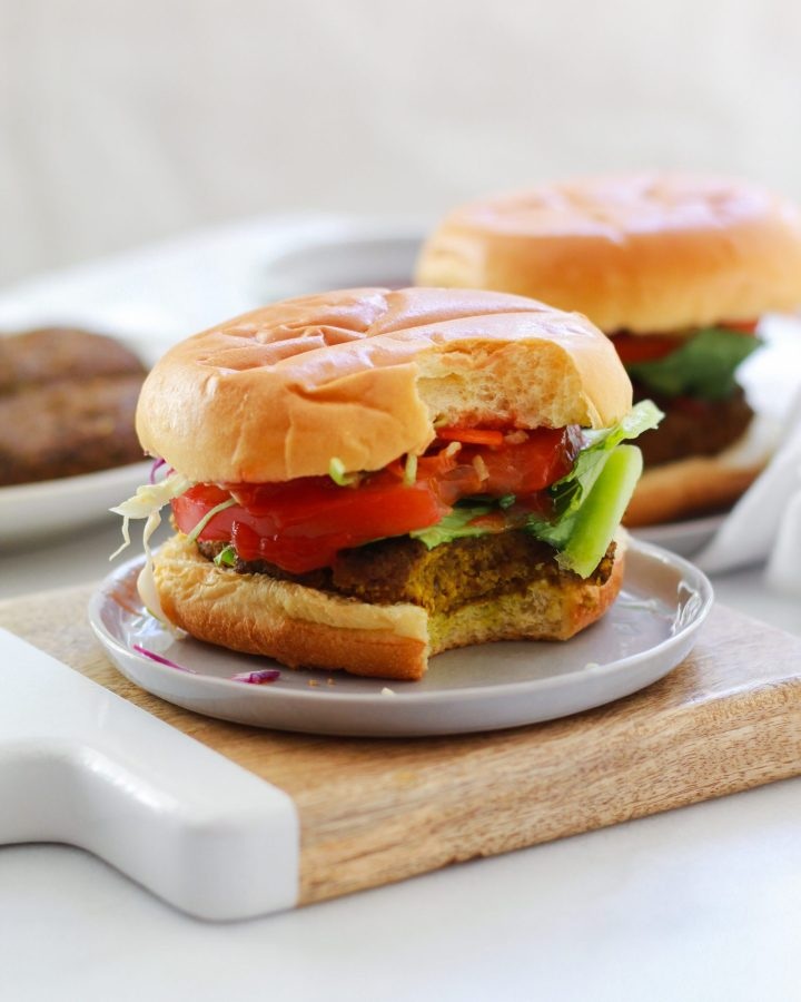 mushroom veggie burger with bite out of it