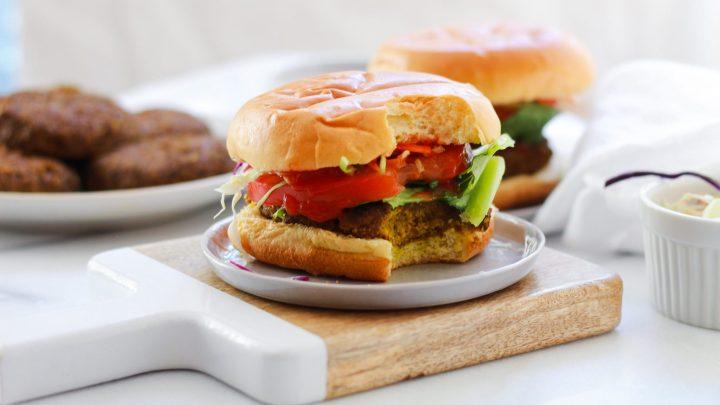 mushroom lentil burger with bite out of it